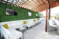 The Rooftop Garden is the premier outdoor space of Wrigleyville that features 2 full service bars, beautiful plant life, several flatscreen TVs, lounge furniture, and heated and canopied.